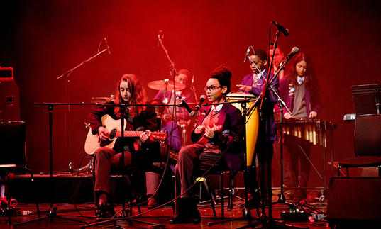 Photo of young people performing music